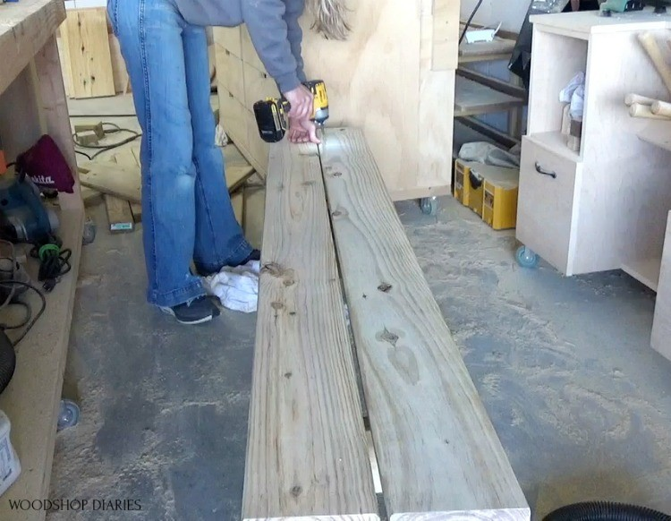 "Using 2"" wood screws to attach bench top boards to bench frame"