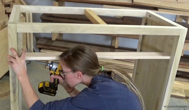Shara Woodshop Diaries installing scrap plywood pieces to use as dresser drawer divider