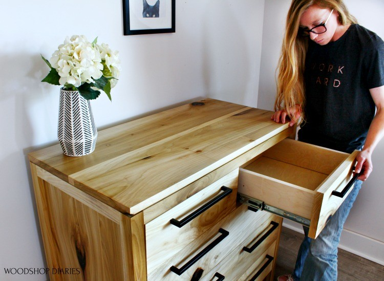 Shara looking into top drawer of finished Modern poplar dresser