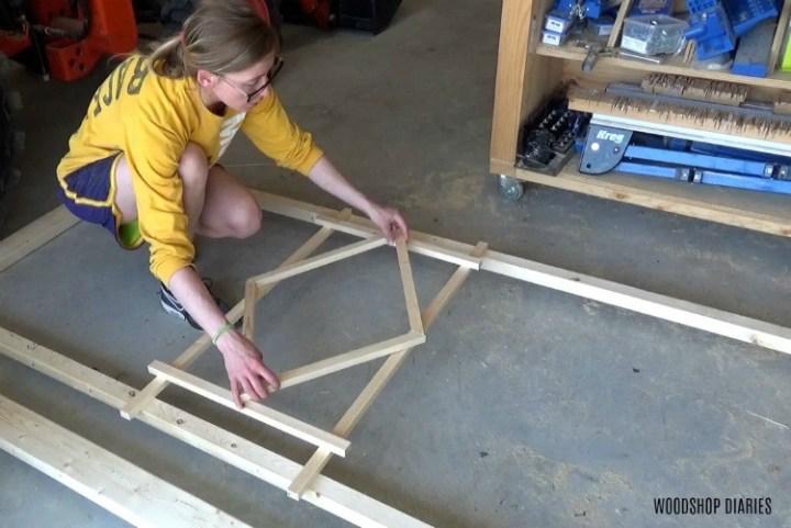 Shara designing diamond shape for center of trellis on garden bed