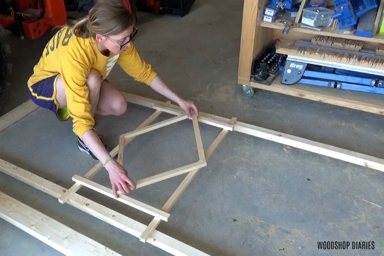 Shara designing diamond shape for center of trellis on garden bed