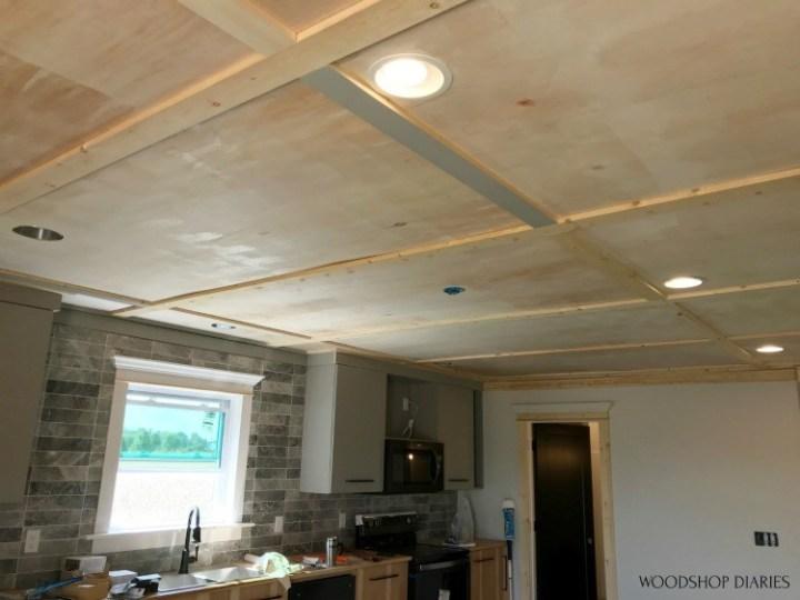 Trim installed on ceiling seams in kitchen