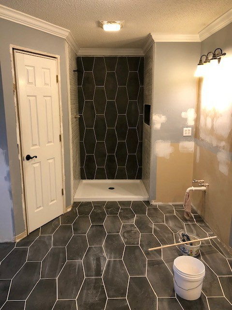 Bathroom renovation tiles grouted on floor and shower walls