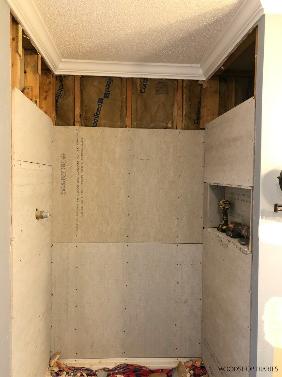 Shower nook with upper drywall removed ready to replace