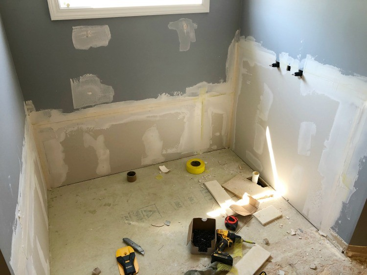 Drywall patched behind previous garden tub