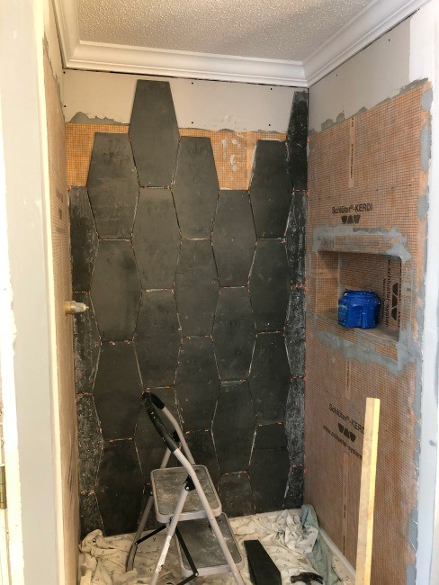 Shower tile on back wall of master bathroom shower nook