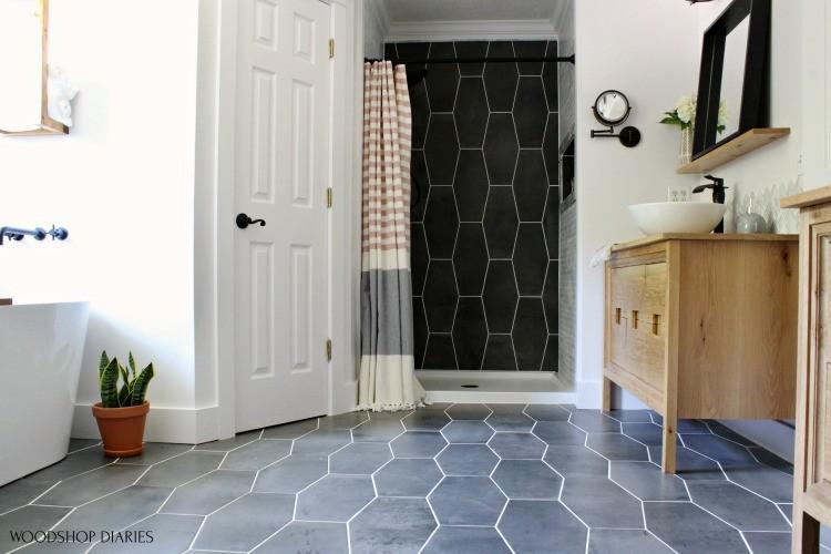 Master Bathroom Final Reveal right side of room shower nook, bathtub nook, vanity and closet view--white oak vanity, dark grey tile