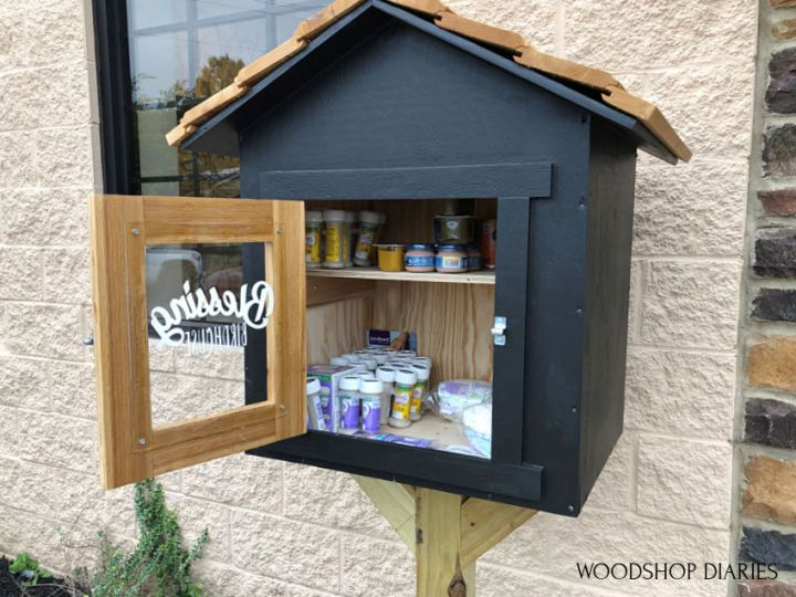Blessing box black and cedar with door open showing stock inside