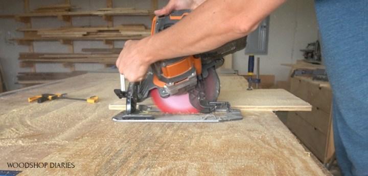 Shara using circular saw at beveled angle to make side panel cuts for blessing box