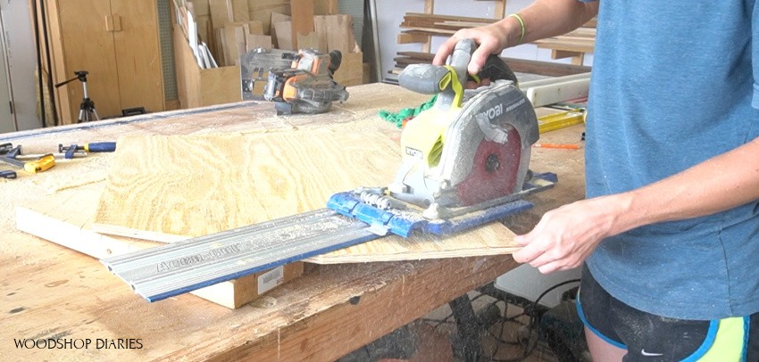 Shara Woodshop Diaries using circular saw to trim roof line of blessing birdhouse