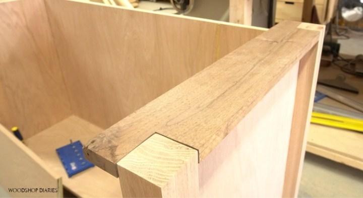 Walnut boards glued in place on desk corners