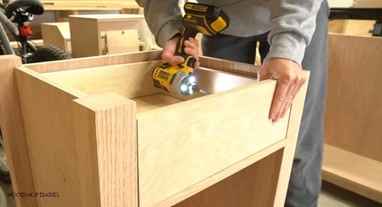 Screwing drawer front onto drawer box
