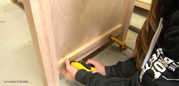 Glue trim pieces onto desk cabinets