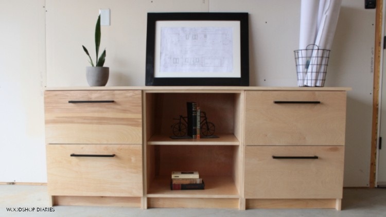 Modular home office storage cabinets--two filing cabinets and a shelving unit set up as a single console cabinet