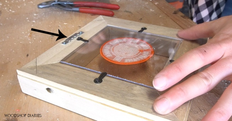 Sawtooth hanger nailed onto back of DIY easy picture frame