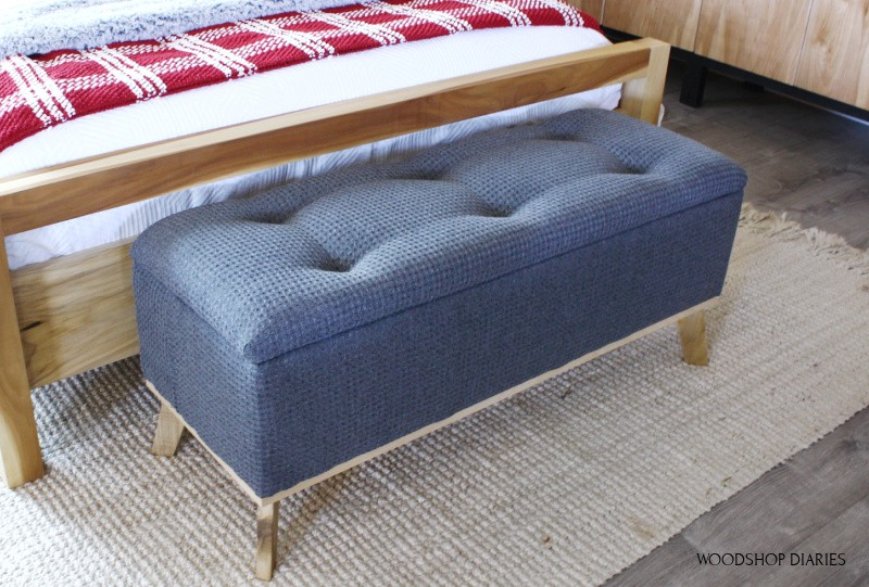 DIY tufted top upholstered storage bench in grey fabric at end of bed