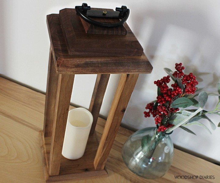 Finished wooden lantern with top handle attached