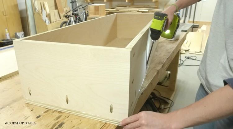 Attaching bottom panel of bench storage box