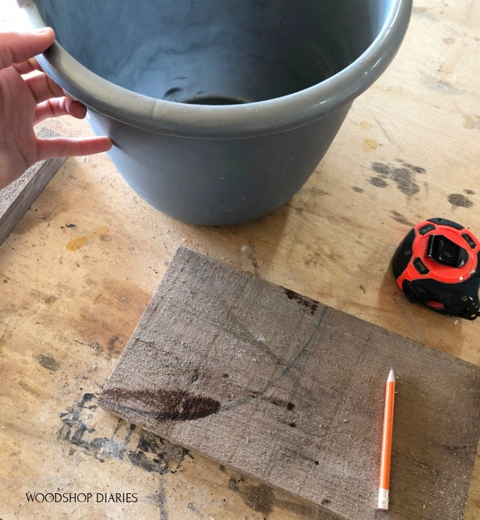 Used water bucket to trace radius onto board