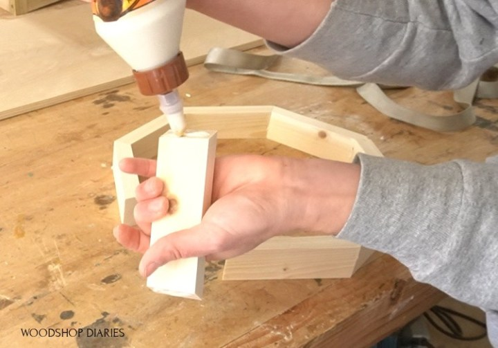 Applying glue to octagon edges to assemble tray sides