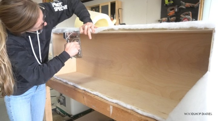 Stapling batting on top edge of upholstered storage bench