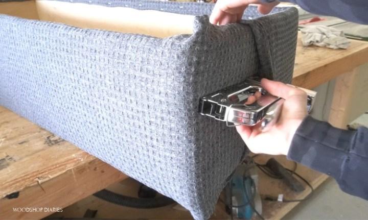 Stapling fabric overlap to hide seams