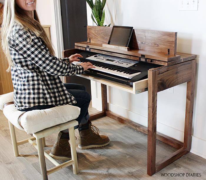 Shara Woodshop Diaries playing keyboard at flip top keyboard stand