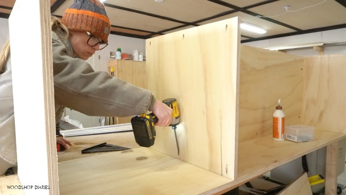 Pocket holes used to assemble middle shelf into cabinet