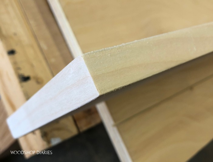 Close up of sanded corner of covered plywood edge