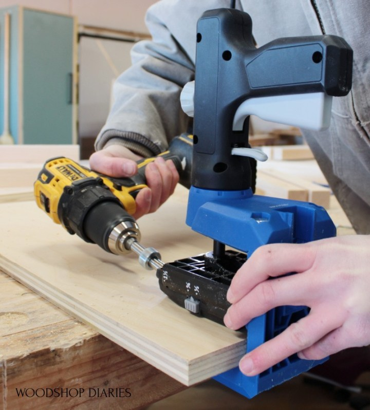 Shara Woodshop Diaries drilling pocket hole into plywood panel using the Kreg 520 jig