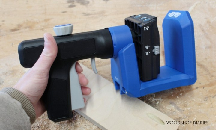 Shara Woodshop Diaries holding the Kreg 520 pocket hole jig