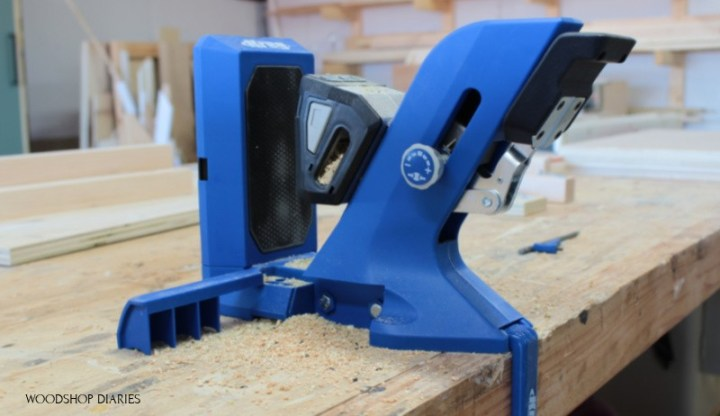 Side view of Kreg 720 pocket hole jig clamped to workbench