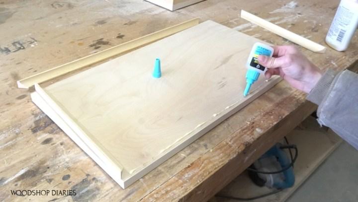 Applying RapidFuse glue between wood glue on drawer front