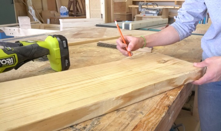 Shara Woodshop Diaries tracing DIY faux live edge onto back panel of floating shelf
