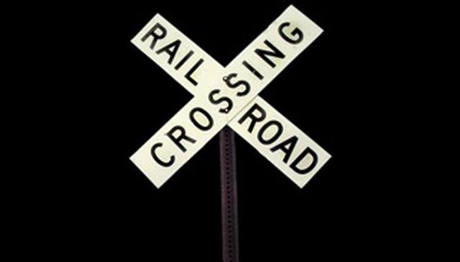 generic railroad crossing generic train_1521079266788.JPG.jpg