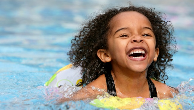 child swimming laughing in pool_44544