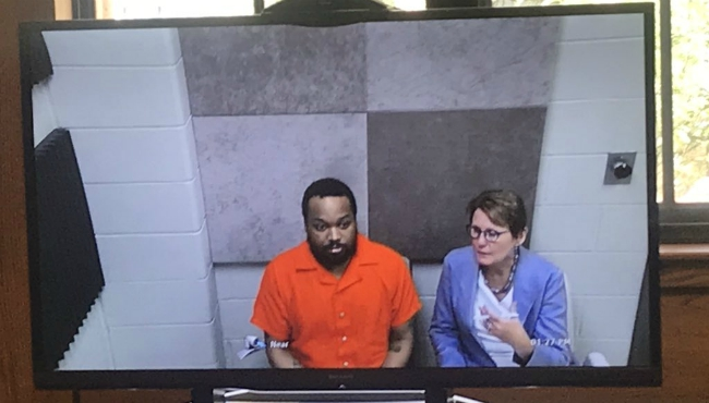 A photo of Darien Gilleylen and his lawyer at a court hearing on July 17, 2019.