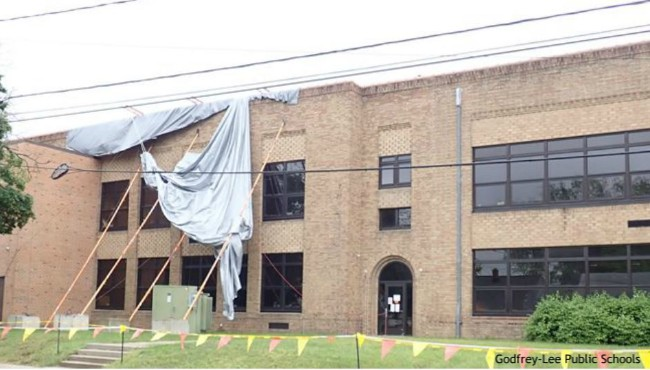 tarp covering top of school building
