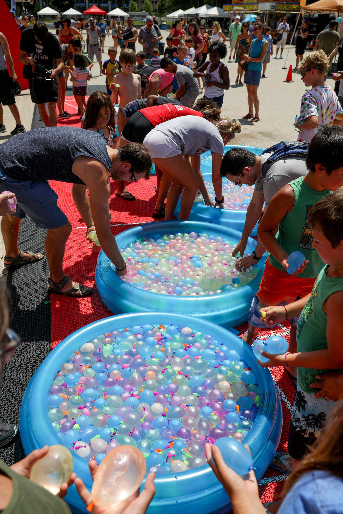 People gathered for the 4th Annual Gains Summer Festival at Calder Plaza in Grand Rapids. It featured many activities, including a giant water balloon fight. (Michael Buck/WOOD TV8)