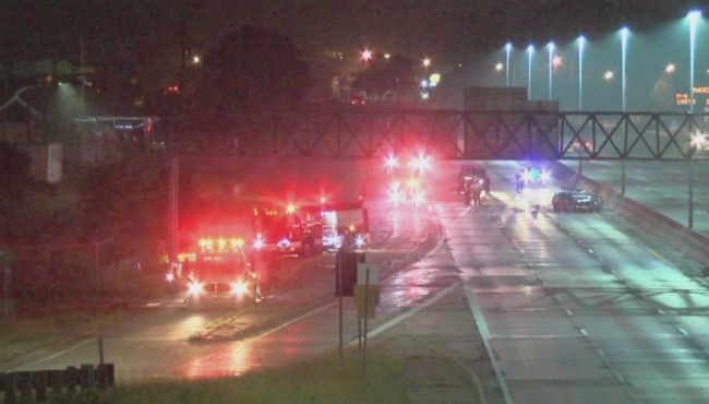 firetrucks and police lights on on highway