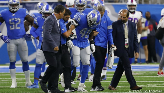Detroit Lions middle linebacker Jarrad Davis (40) is helped off the field by medical staff during the first half of the team's NFL preseason football game against the Buffalo Bills in Detroit, Friday, Aug. 23, 2019. (AP Photo/Rick Osentoski)