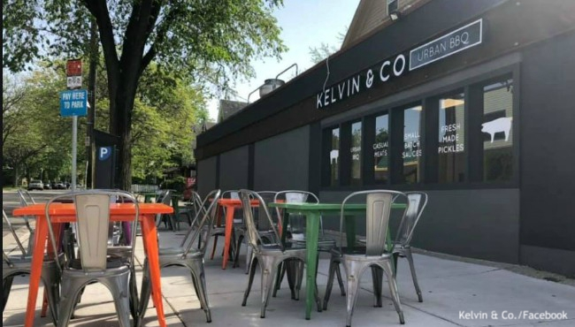 Restaurant front with sidewalk patio filled with tables and chairs
