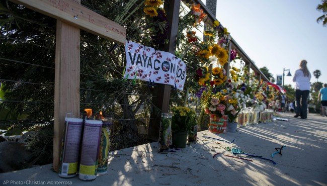 """A wooden cross and a sign that reads """"Go With God"""" in Spanish are displayed at a memorial site for the victims of the diving boat Conception on Tuesday, Sept. 3, 2019, in Santa Barbara, Calif."""