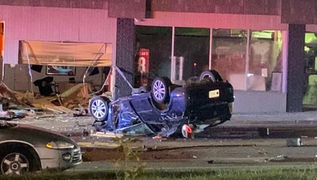 Police on the scene of a crash on Bridge Street in Grand Rapids Thursday, Oct. 17, 2019.