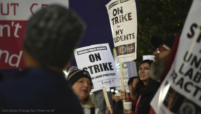 Chicago Public Schools teachers picket early Thursday morning, Oct. 17, 2019, at Lane Tech High School on the first day of a teacher's strike, in Chicago. (Colin Boyle/Chicago Sun-Times via AP)