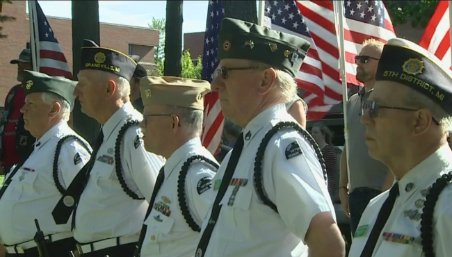 A photo of people honoring of veteran James Kelly at his funeral in August.