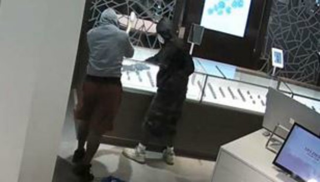 Surveillance photos of two robbery suspects at the Helzberg Diamonds in Portage on Aug. 30, 2018.
