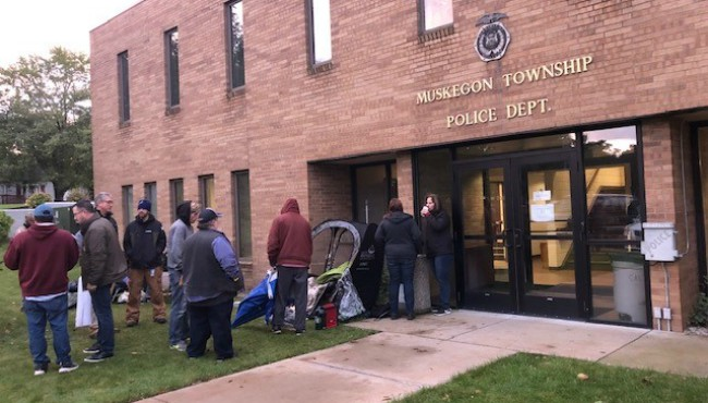 People line up at the Muskegon Township Hall for recreational marijuana licenses Thursday, Oct. 17, 2019.