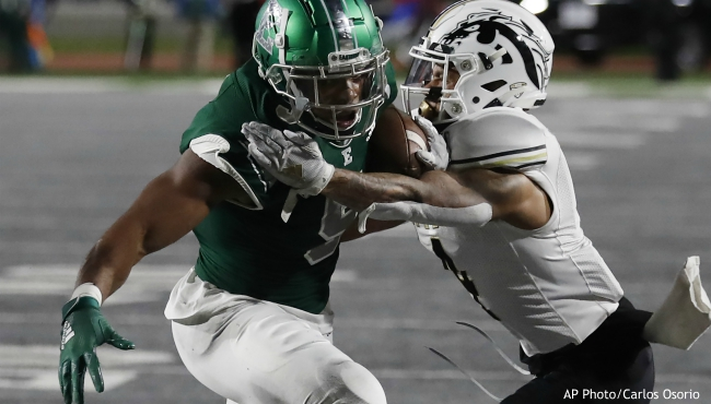 Eastern Michigan running back Shaq Vann (5) is tackled by Western Michigan cornerback Patrick Lupro during the first half of an NCAA college football game, Saturday, Oct. 19, 2019, in Ypsilanti, Mich. (AP Photo/Carlos Osorio)