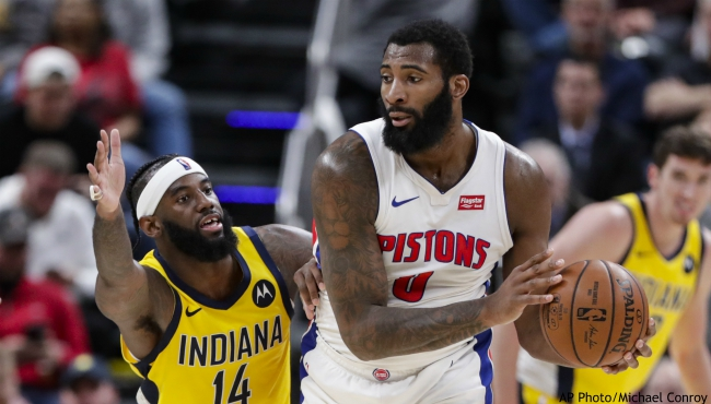 Indiana Pacers forward JaKarr Sampson (14) defends against Detroit Pistons center Andre Drummond (0) during the second half of an NBA basketball game in Indianapolis, Friday, Nov. 8, 2019. The Pacers won 112-106. (AP Photo/Michael Conroy)